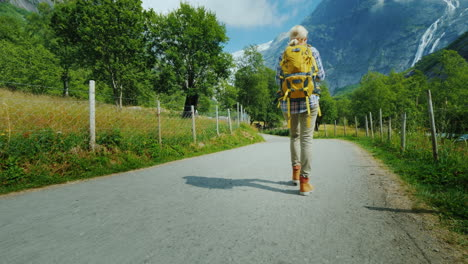 The-Incredibly-Beautiful-Nature-Of-Norway---A-Woman-With-A-Backpack-Walking-Along-A-Path-Against-The