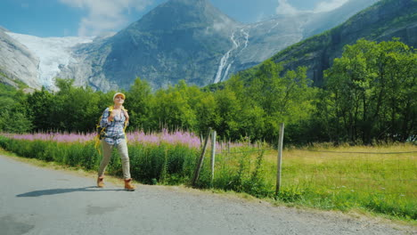The-Woman-Admires-With-Admiration-The-Beautiful-Nature-Of-Norway-Walks-Along-The-Path-Against-The-Ba
