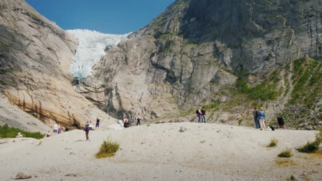 People-Are-Visiting-The-Famous-Brixdal-Glacier-In-Norway-Tourism-In-The-Nordic-Countries-And-Scandin