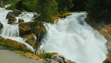 Waters-Of-The-Waterfall-At-The-Bottom-Of-The-Bridge-In-The-Distance-Meltwater-From-The-Glaciers-In-T
