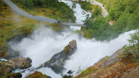 The-Traveler-Admires-The-Stormy-Mountain-River-Originating-In-The-Briksdal-Glacier-The-Majestic-Scen