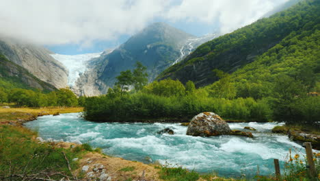 Briksdal-Glacier-With-A-Mountain-River-In-The-Foreground