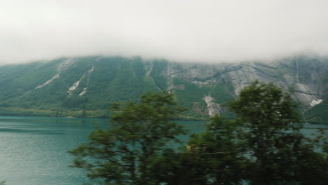 The-Shore-Of-The-Fjord-The-Top-Of-The-Mountains-Are-Drowning-In-The-Clouds-View-From-The-Window-Of-T