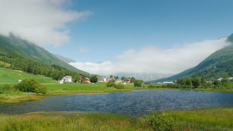 Scenic-Landscape-Of-Norway---Along-The-Lake-There-Is-A-Road-In-The-Background-There-Are-Mountains-4k