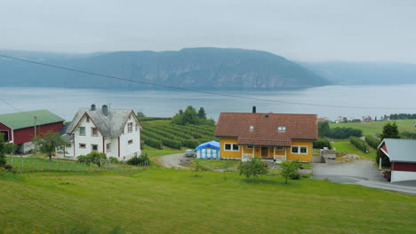 Ride-Along-The-Shore-Of-The-Fjord-From-The-Window-Of-A-Car-You-Can-See-Old-Houses-And-The-Picturesqu