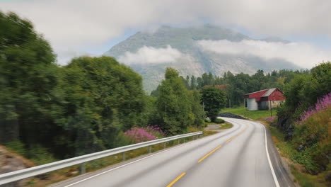 Drive-Along-The-Handsome-Road-Among-The-Mountains-Of-Norway-Pov-View-From-The-Bus-Window