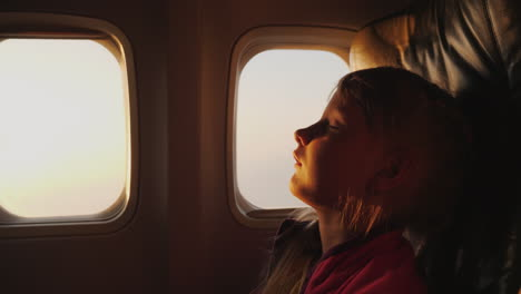 A-Difficult-Flight-For-A-Little-Girl-A-Sleeping-Child-In-The-Background-Of-The-Rising-Sun-In-The-Air