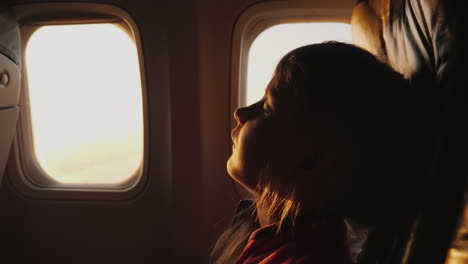 Sleep-Anywhere-And-In-Any-Position-A-Little-Girl-Is-Sleeping-In-An-Armchair-Aboard-An-Airplane-Morni