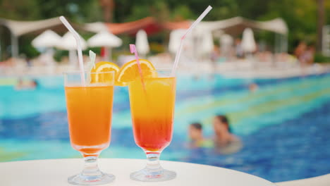 Two-Exotic-Cocktails-On-The-Background-Of-The-Pool-At-The-Tourist-Resort