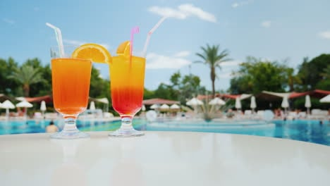 Bright-Impressions-Of-The-Beach-Holiday-Near-The-Pool-Two-Glasses-Of-Colorful-Alcoholic-Cocktail-On-