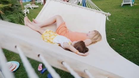 Two-Girls-In-Bright-Summer-Clothes-Are-Lying-On-The-Deckchair-Having-Fun-Enjoying-The-Rest-View-From