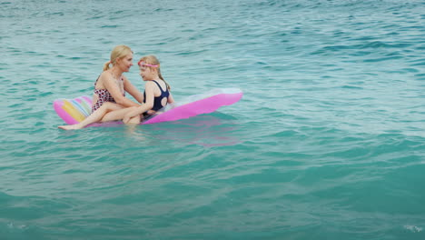 An-Active-Family-Vacation-With-Children-A-Young-Woman-With-A-Daughter-Are-Fun-To-Ride-The-Waves-On-A