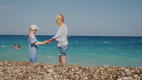 Mom-And-Daughter-Are-Having-Fun-In-Surf-Waves-On-The-Sea-Happy-Moments-With-Children-Slow-Motion-Vid