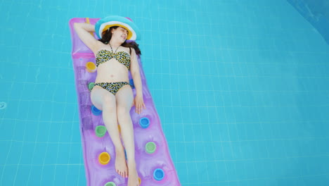 Young-Sexy-Woman-Sunbathing-On-An-Inflatable-Mattress-Luxuriate-Under-The-Sun-In-The-Pool-4k-Video