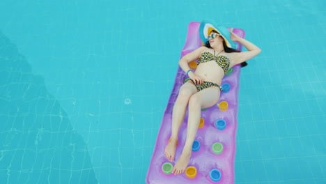 Full-Relaxation-And-No-Work-And-Mobile-Phones-The-Girl-Is-Sunbathing-On-The-Mattress-In-The-Blue-Poo