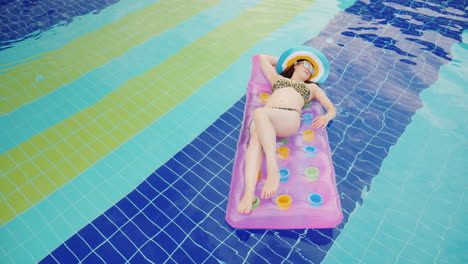 An-Attractive-Young-Woman-In-A-Hat-Is-Floating-On-An-Inflatable-Mattress-In-The-Pool-Ideal-Vacation-
