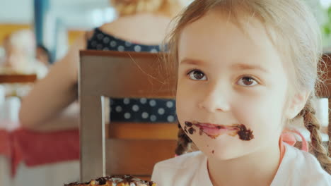 A-Little-Naughty-Girl-With-A-Chocolate-Smeared-Face-Smiles-Into-The-Camera-Portrait