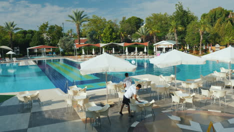 The-Hotel-Staff-Removes-The-Territory-In-A-Five-Star-Hotel-Near-The-Pool-There-Are-Tables-And-Umbrel