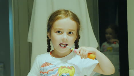 Healthy-Teeth-From-Early-Childhood-A-Small-Child-Cleans-His-Teeth-Before-Going-To-Bed-In-Front-Of-A-