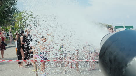 A-Group-Of-People-Having-Fun-On-The-Beach-Under-The-Streams-Of-Foam-A-Foam-Party