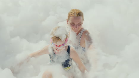 A-Foam-Party-In-A-Resort-Hotel-On-The-Beach-A-Young-Mother-With-Her-Daughter-Having-Fun-In-A-Huge-Am