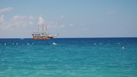Ship-Stylized-Pirate-Sailboat-Sailing-On-The-Sea-Black-Sea-Near-Kemer