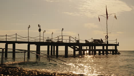Pier-On-The-Turkish-Shore-On-The-Flagstaff-Turkish-Flag-Early-Morning-At-The-Sea-4k-Video