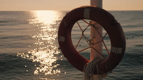 Lifebuoy-Near-The-Sea-Early-Morning-The-Sun-Has-Just-Risen-4k-Video