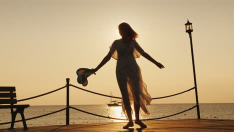A-Woman-Meets-The-Dawn-At-Sea-Emotionally-Spinning-With-A-Hat-In-His-Hand-On-The-Pier-Dream-Of-Trave