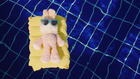 A-Cool-Rabbit-In-Sun-Glasses-Glows-On-An-Inflatable-Mattress-Floats-In-The-Pool-Vacation-With-Childr