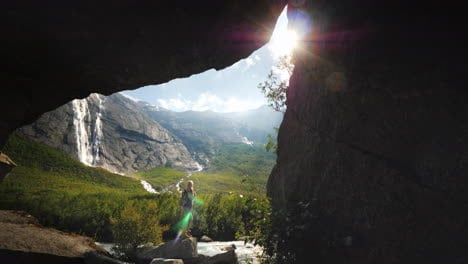 View-Through-The-Arch-In-The-Rock-On-The-Lone-Figure-Of-A-Woman-Among-A-Delightful-Nature-Surrounded