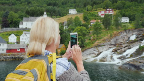 Traveler-Photographs-A-Picturesque-Landscape-In-Norway-A-Waterfall-And-Traditional-Norwegian-Houses