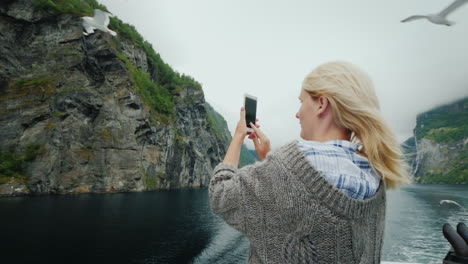 The-Tourist-Photographs-Beautiful-Fjords-And-Seagulls-That-Fly-Nearby-Cruise-On-The-Fjords-Of-Norway