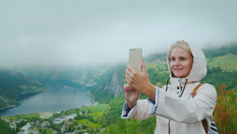A-Happy-Tourist-Is-Photographed-Against-The-Background-Of-A-Picturesque-Fjord-In-Norway-It-Is-Worth-