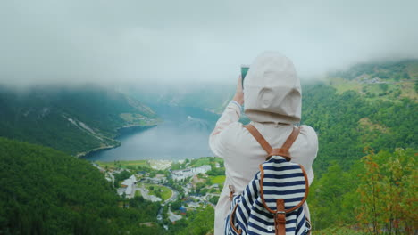 Woman-Traveler-Photographs-A-Scenic-View-Of-The-Fjord-In-Norway-A-Trip-To-Scandinavia