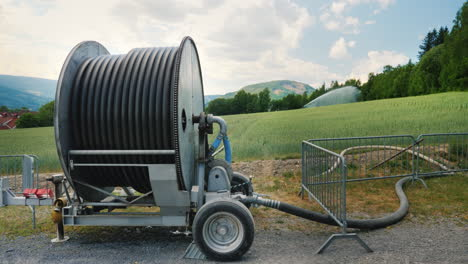 Watering-The-Wheat-Field-In-The-Foreground-Is-A-Large-Coil-With-A-Water-Hose-Agriculture-In-Norway-4