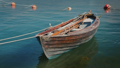 An-Old-Fishing-Boat-Moored-Offshore-4k-Video