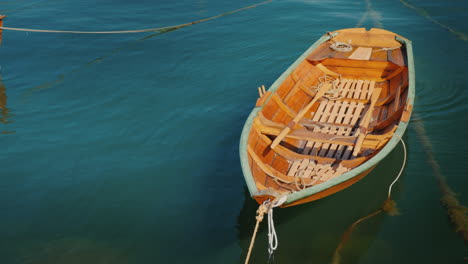 A-New-Wooden-Boat-Is-Moored-Offshore-4k-Video