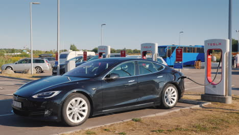 Black-Car-Brand-Tesla-Is-Charged-On-The-Branded-Free-Fast-Charging-Station