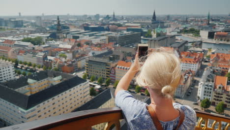 A-Woman-Takes-A-View-From-Above-The-City-Of-Copenhagen-In-Denmark