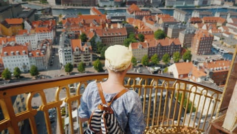 A-Tourist-With-A-Backpack-And-The-Flag-Of-Denmark-Rises-Up-The-Famous-Spiral-Staircase-Of-The-Church