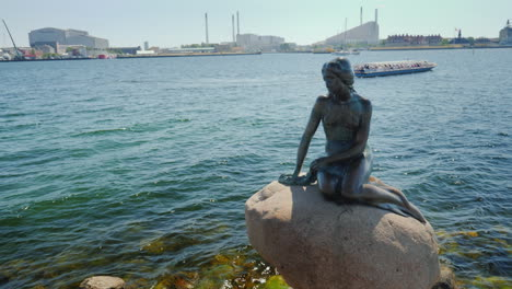 Monument-To-A-Little-Mermaid-In-The-Harbor-Of-Copenhagen-In-The-Background-You-Can-See-A-Sightseeing