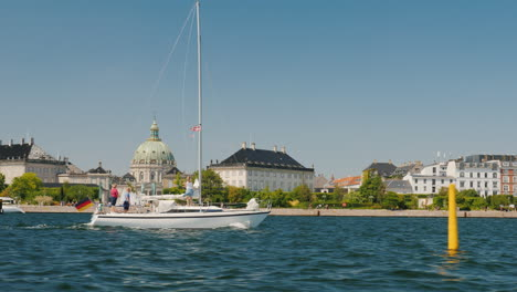 The-Yacht-With-The-Flag-Of-Germany-Sails-Against-The-Background-Of-Copenhagen-s-City-Line-Euro-Trip