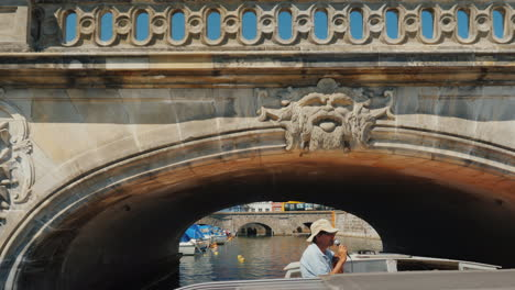 The-Sightseeing-Boat-Sails-Under-A-Beautiful-Old-Bridge-Cruise-Through-The-Canals-Of-Copenhagen