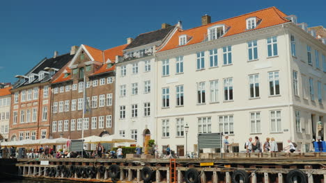 Tour-Through-The-Canals-Of-Copenhagen-A-Boat-With-Tourists-Sailing-Along-A-Narrow-Canal