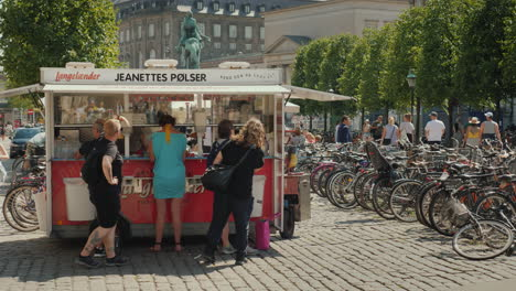 Mobile-Snack-Bar-In-Copenhagen-Street-Near-It-There-Is-A-Queue-Of-Buyers