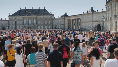 A-Crowd-Of-People-Running-To-Take-Pictures-And-Look-At-The-Changing-Of-The-Guard-At-The-Royal-Palace
