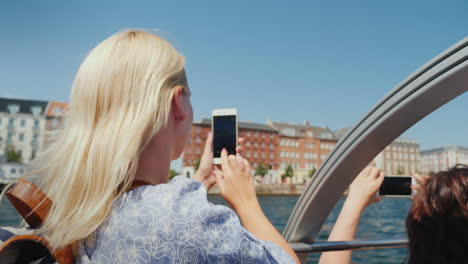A-Woman-Takes-Pictures-Of-Copenhagen-s-Sights-Sails-On-The-Excursion-Ship-Through-The-City-s-Canals