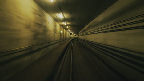 A-First-Person-View-Of-The-Subway-Tunnel-Movement-In-A-Circular-Tunnel-Creates-A-Hypnotic-Effect-4k-