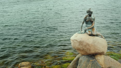 The-Statue-Of-The-Little-Mermaid-Becomes-Wet-Under-The-Rains-In-The-Bay-Of-Copenhagen